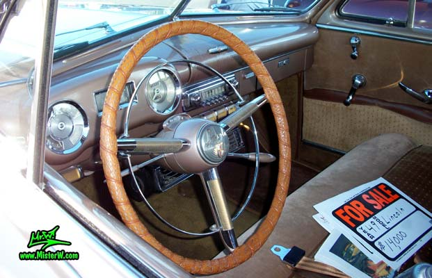 Photo of a tan 1949 Lincoln 9EL Series 4 door Sport Sedan with suicide doors at the Scottsdale Pavilions Classic Car Show in Arizona. Dash board & speedometer of a 1949 Lincoln 9EL Series Sport Sedan