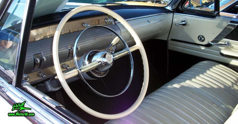 Photo of a white 1954 Lincoln Capri 2 door convertible at the Scottsdale Pavilions Classic Car Show in Arizona. Dash board & speedometer of a 1954 Lincoln Capri convertible