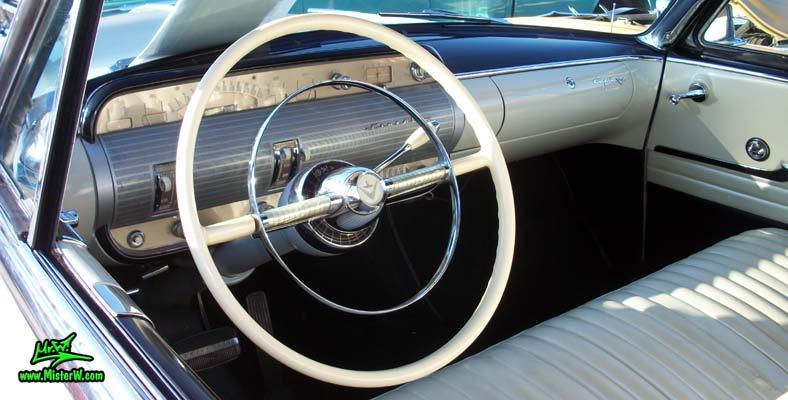 Photo of a white 1954 Lincoln Capri 2 door convertible at the Scottsdale Pavilions Classic Car Show in Arizona. Dashboard, speedometer & odometer of a 1954 Lincoln Capri convertible