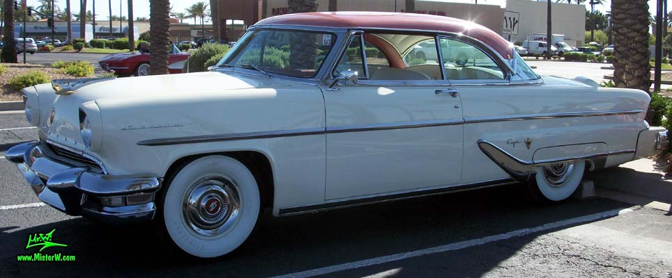 Photo of a white 1955 Lincoln Capri 2 door hardtop coupe at the Scottsdale Pavilions Classic Car Show in Arizona. 55 Lincoln Capri