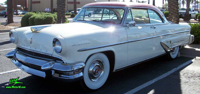 Photo of a white 1955 Lincoln Capri 2 door hardtop coupe at the Scottsdale Pavilions Classic Car Show in Arizona. 1955 Lincoln Hardtop Coupe