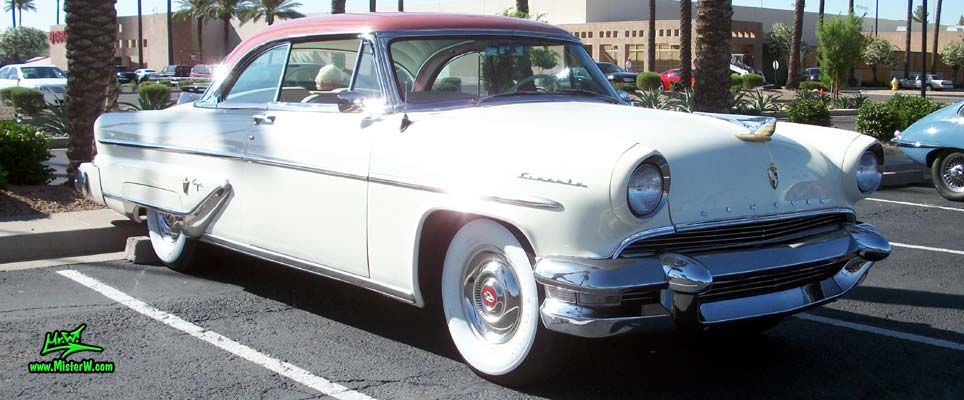 Photo of a white 1955 Lincoln Capri 2 door hardtop coupe at the Scottsdale Pavilions Classic Car Show in Arizona. Chrome trim of a 1955 Lincoln Capri hardtop coupe