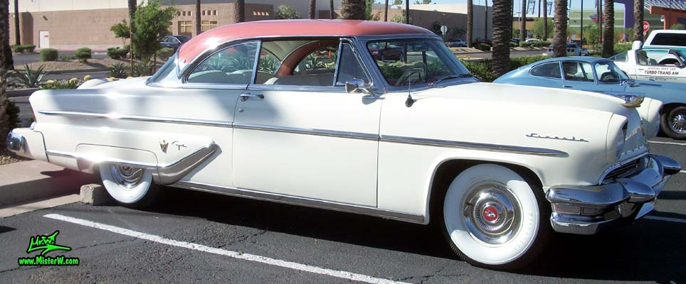 Photo of a white 1955 Lincoln Capri 2 door hardtop coupe at the Scottsdale Pavilions Classic Car Show in Arizona. 55 Lincoln Capri Coupe