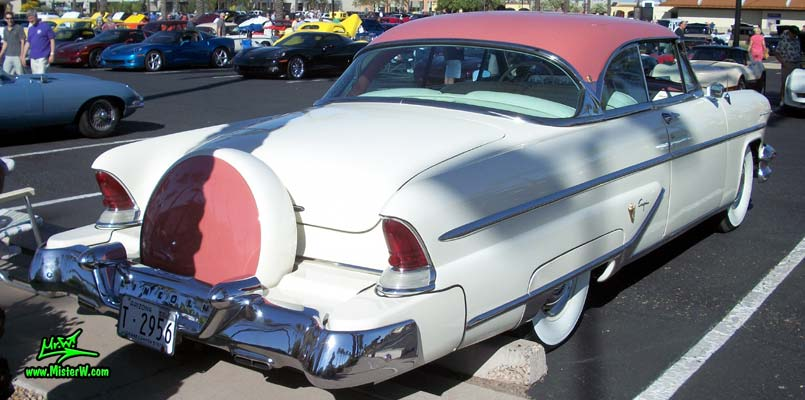 Photo of a white 1955 Lincoln Capri 2 door hardtop coupe at the Scottsdale Pavilions Classic Car Show in Arizona. Tailfins & continental kit of a 1955 Lincoln Capri hardtop coupe
