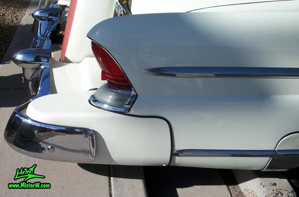 Photo of a white 1955 Lincoln Capri 2 door hardtop coupe at the Scottsdale Pavilions Classic Car Show in Arizona. Tail fin of a 1955 Lincoln Capri hardtop coupe
