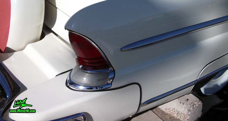Photo of a white 1955 Lincoln Capri 2 door hardtop coupe at the Scottsdale Pavilions Classic Car Show in Arizona. Tail light & fin of a 1955 Lincoln Capri hardtop coupe