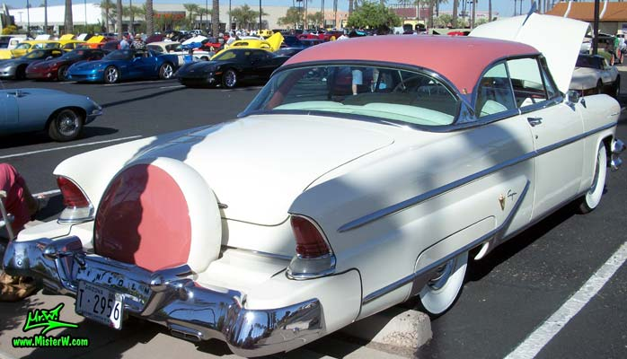 Photo of a white 1955 Lincoln Capri 2 door hardtop coupe at the Scottsdale Pavilions Classic Car Show in Arizona. Tail fins of a 1955 Lincoln Capri