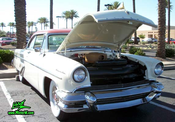 Photo of a white 1955 Lincoln Capri 2 door hardtop coupe at the Scottsdale Pavilions Classic Car Show in Arizona. 1955 Lincoln Capri hardtop coupe with open hood