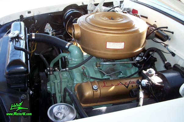 Photo of a white 1955 Lincoln Capri 2 door hardtop coupe at the Scottsdale Pavilions Classic Car Show in Arizona. Engine compartment of a 1955 Lincoln Capri hardtop coupe