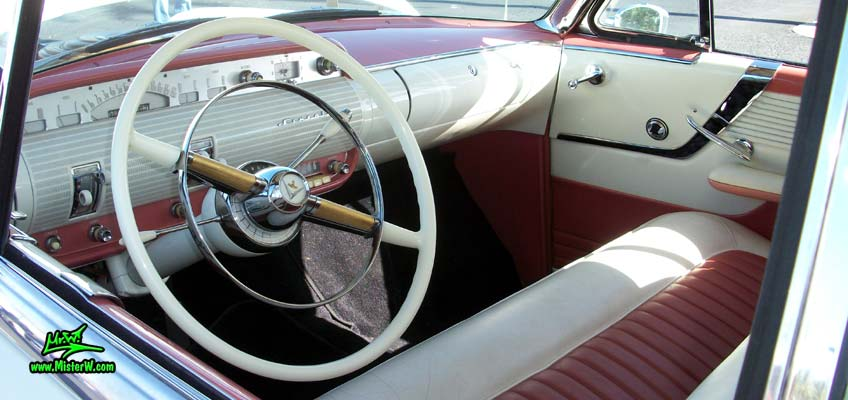 Photo of a white 1955 Lincoln Capri 2 door hardtop coupe at the Scottsdale Pavilions Classic Car Show in Arizona. Interior & dashboard of a 1955 Lincoln Capri hardtop coupe