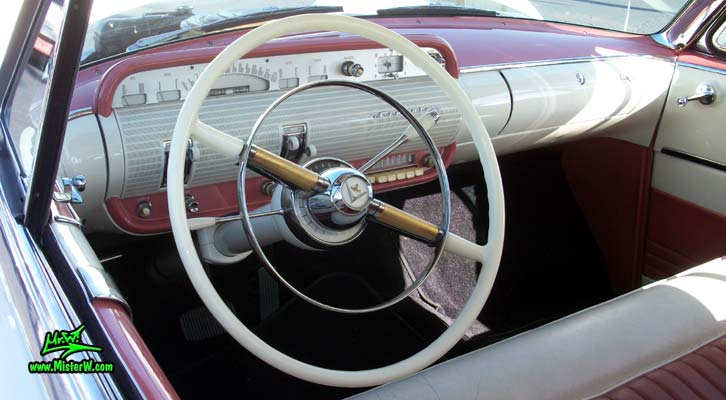 Photo of a white 1955 Lincoln Capri 2 door hardtop coupe at the Scottsdale Pavilions Classic Car Show in Arizona. Dash board & speedometer of a 1955 Lincoln Capri hardtop coupe