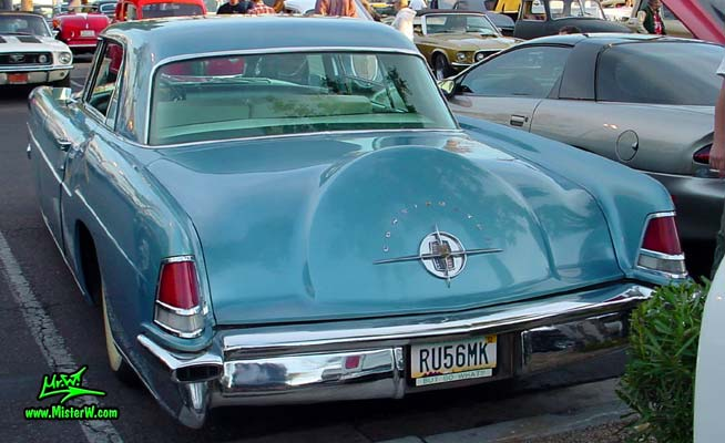 Photo of a blue metallic 1956 Lincoln Continental Mark 2 hardtop coupe at the Scottsdale Pavilions Classic Car Show in Arizona. Rearview of a 1956 Lincoln Continental Mark 2