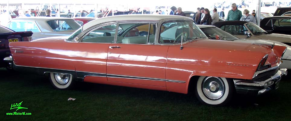 Photo of a pink 1956 Lincoln Premiere 2 door hardtop coupe at a Classic Car Auction in Scottsdale, Arizona. 1956 Lincoln Premiere