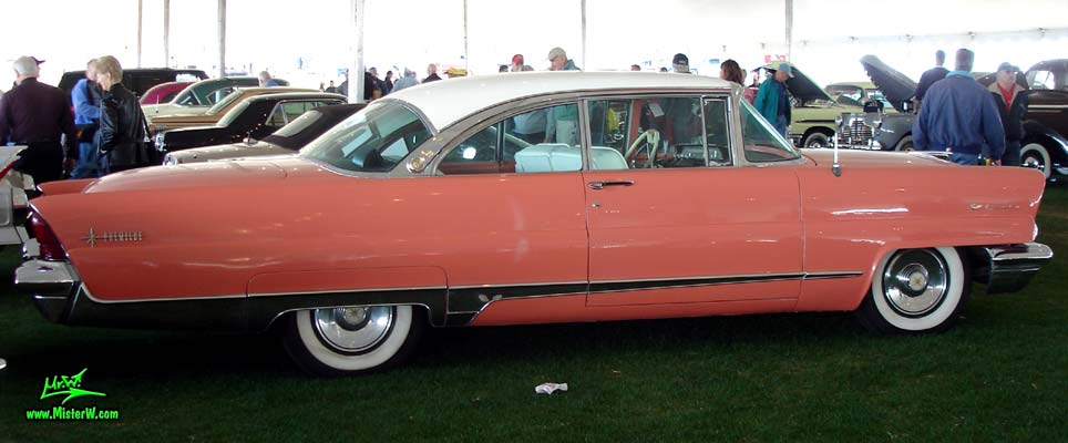 Photo of a pink 1956 Lincoln Premiere 2 door hardtop coupe at a Classic Car Auction in Scottsdale, Arizona. Sideview of a 1956 Lincoln Premiere