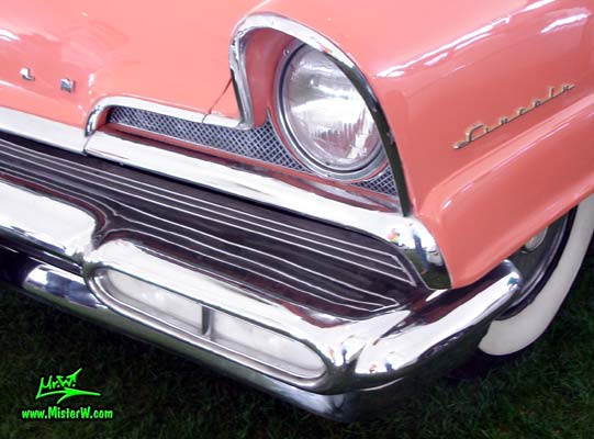 Photo of a pink 1956 Lincoln Premiere 2 door hardtop coupe at a Classic Car Auction in Scottsdale, Arizona. 1956 Lincoln Front Bumper Corner