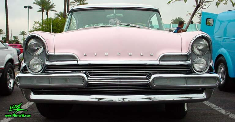 Photo of a pink & white 1957 Lincoln Premiere 2 door hardtop coupe at the Scottsdale Pavilions Classic Car Show in Arizona. Front view of a 1957 Lincoln Premiere hardtop coupe