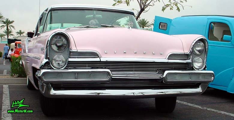 Photo of a pink & white 1957 Lincoln Premiere 2 door hardtop coupe at the Scottsdale Pavilions Classic Car Show in Arizona. Front chrome grill of a 1957 Lincoln Premiere hardtop coupe