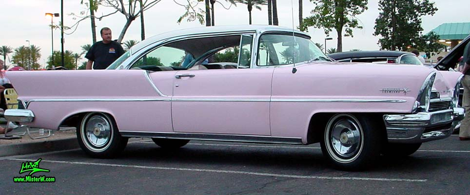 Photo of a pink & white 1957 Lincoln Premiere 2 door hardtop coupe at the Scottsdale Pavilions Classic Car Show in Arizona. Side view of a 1957 Lincoln Premiere hardtop coupe