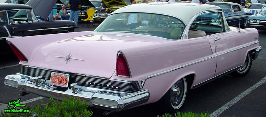 Photo of a pink & white 1957 Lincoln Premiere 2 door hardtop coupe at the Scottsdale Pavilions Classic Car Show in Arizona. Tail fins of a 1957 Lincoln Premiere hardtop coupe