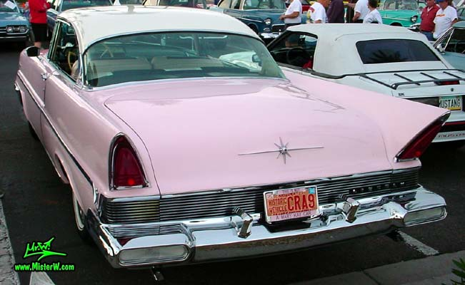 Photo of a pink & white 1957 Lincoln Premiere 2 door hardtop coupe at the Scottsdale Pavilions Classic Car Show in Arizona. Rear bumper of a 1957 Lincoln Premiere hardtop coupe