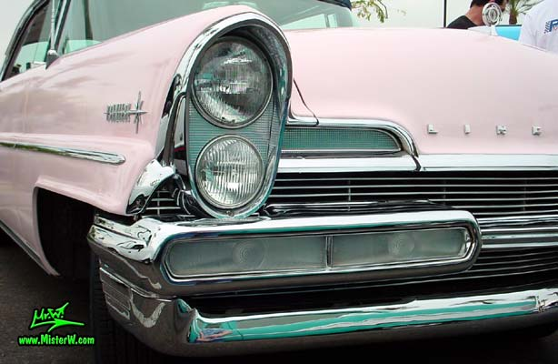 Photo of a pink & white 1957 Lincoln Premiere 2 door hardtop coupe at the Scottsdale Pavilions Classic Car Show in Arizona. Front blinker of a 1957 Lincoln Premiere hardtop coupe