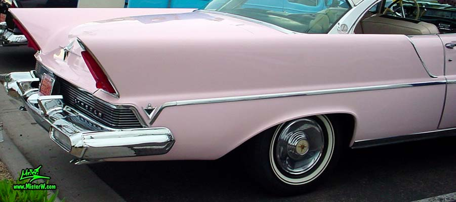 Photo of a pink & white 1957 Lincoln Premiere 2 door hardtop coupe at the Scottsdale Pavilions Classic Car Show in Arizona. Tailfin of a 1957 Lincoln Premiere hardtop coupe