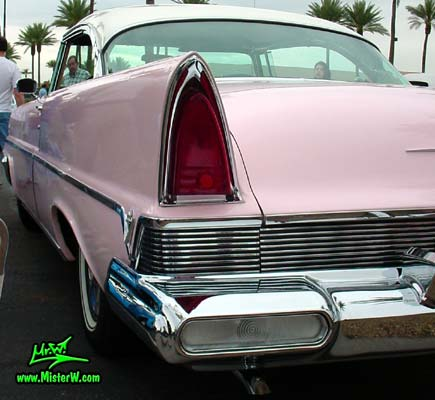 Photo of a pink & white 1957 Lincoln Premiere 2 door hardtop coupe at the Scottsdale Pavilions Classic Car Show in Arizona. Tail light & fin of a 1957 Lincoln Premiere hardtop coupe