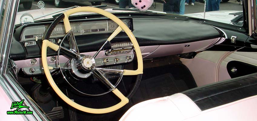Photo of a pink & white 1957 Lincoln Premiere 2 door hardtop coupe at the Scottsdale Pavilions Classic Car Show in Arizona. Dash board & speedometer of a 1957 Lincoln Premiere hardtop coupe