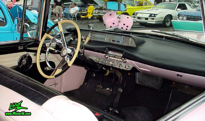 Photo of a pink & white 1957 Lincoln Premiere 2 door hardtop coupe at the Scottsdale Pavilions Classic Car Show in Arizona. Interior & dashboard of a 1957 Lincoln Premiere hardtop coupe