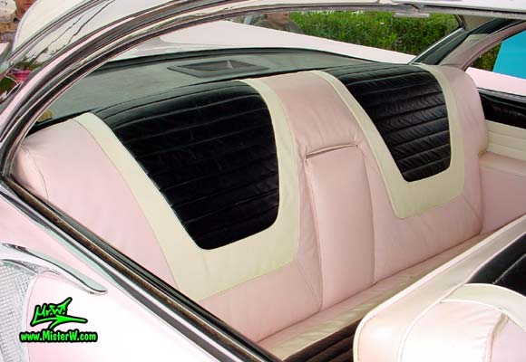Photo of a pink & white 1957 Lincoln Premiere 2 door hardtop coupe at the Scottsdale Pavilions Classic Car Show in Arizona. Interior & rear seat bench of a 1957 Lincoln Premiere hardtop coupe