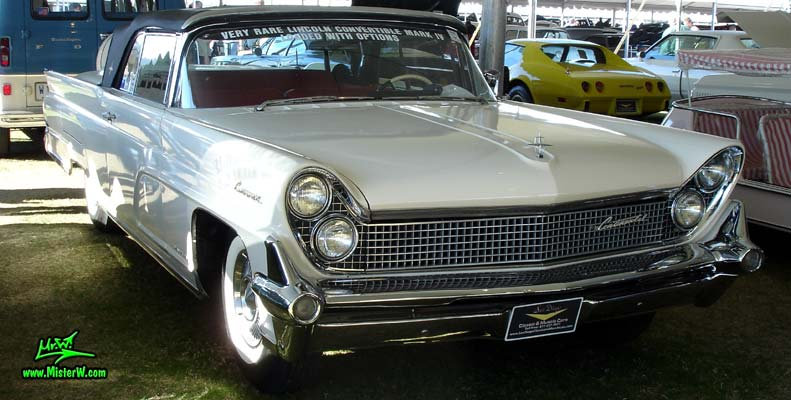 Photo of a white 1959 Lincoln Continental Mark IV convertible at a Classic Car Auction in Scottsdale, Arizona. Front chrome grill of a 1959 Lincoln Continental Mark IV Convertible
