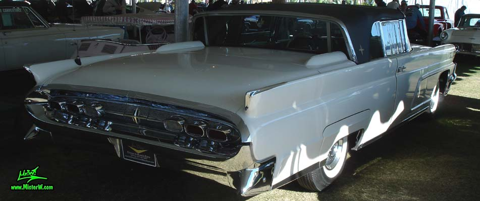Photo of a white 1959 Lincoln Continental Mark IV convertible at a Classic Car Auction in Scottsdale, Arizona. Side view of a 1959 Lincoln Continental Mark IV Convertible