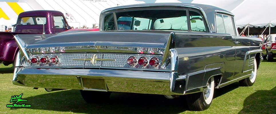 Photo of a silver gray metallic 1960 Lincoln Continental Mark V 2 door hardtop coupe at a Classic Car Auction in Scottsdale, Arizona. Tail fins of a 1960 Lincoln Continental Mark V coupe