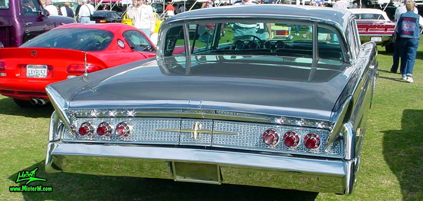 Photo of a silver gray metallic 1960 Lincoln Continental Mark V 2 door hardtop coupe at a Classic Car Auction in Scottsdale, Arizona. Tail lights of a 1960 Lincoln Continental Mark V coupe
