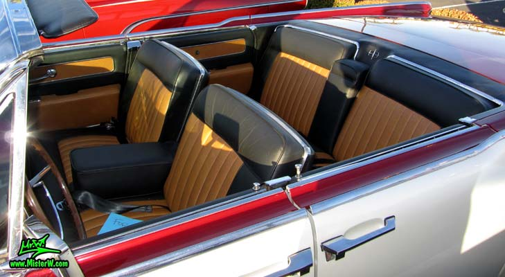 Photo of a red & white 1961 Lincoln Continental 4 door convertible at the Scottsdale Pavilions Classic Car Show in Arizona. Interior of a 1961 Lincoln Continental convertible