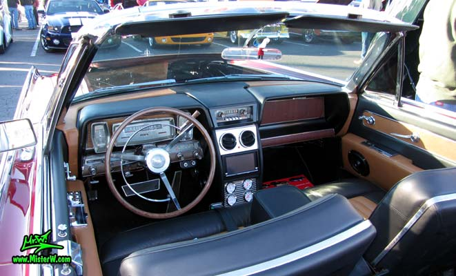 Photo of a red & white 1961 Lincoln Continental 4 door convertible at the Scottsdale Pavilions Classic Car Show in Arizona. Dash board of a 1961 Lincoln Continental convertible