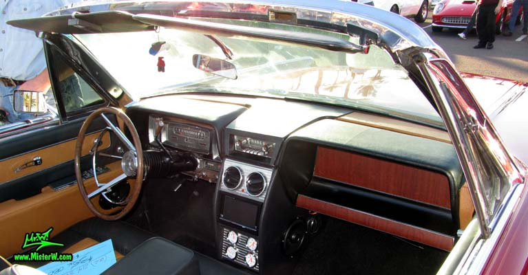 Photo of a red & white 1961 Lincoln Continental 4 door convertible at the Scottsdale Pavilions Classic Car Show in Arizona. Dashboard & interior of a 1961 Lincoln Continental convertible