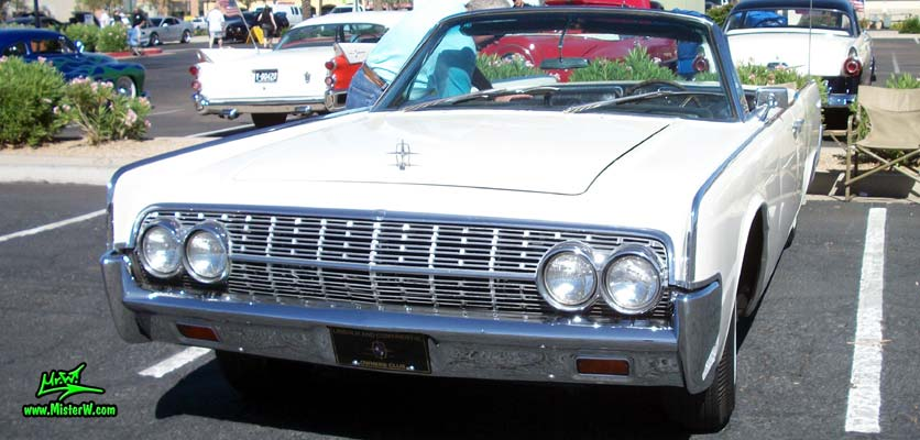 Photo of a white 1962 Lincoln Continental 4 door convertible at the Scottsdale Pavilions Classic Car Show in Arizona. 1962 Lincoln