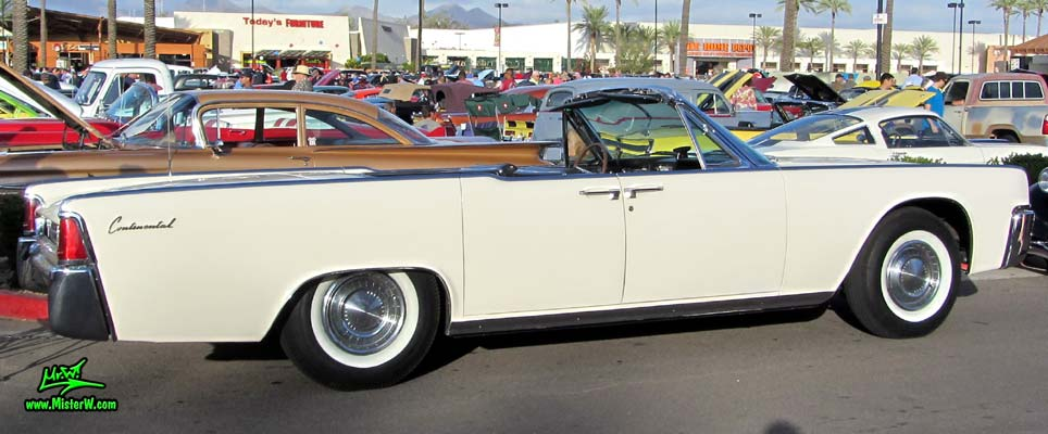 Photo of a white 1962 Lincoln Continental 4 door convertible at the Scottsdale Pavilions Classic Car Show in Arizona. Side lines of a 1962 Lincoln Continental convertible