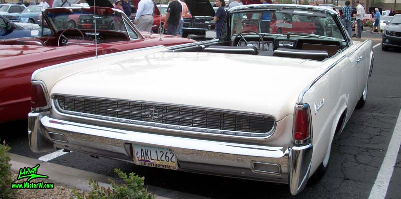 Photo of a white 1962 Lincoln Continental 4 door convertible at the Scottsdale Pavilions Classic Car Show in Arizona. Rear view of a 1962 Lincoln Continental convertible