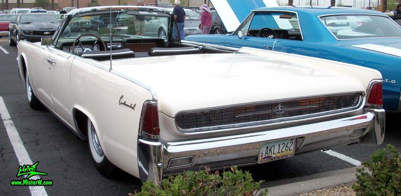 Photo of a white 1962 Lincoln Continental 4 door convertible at the Scottsdale Pavilions Classic Car Show in Arizona. Tail fins of a 1962 Lincoln Continental convertible