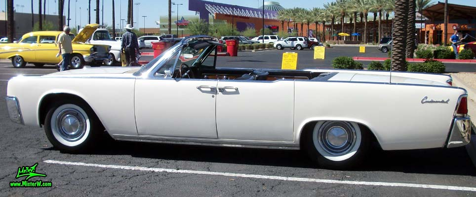 Photo of a white 1962 Lincoln Continental 4 door convertible at the Scottsdale Pavilions Classic Car Show in Arizona. 1962 Lincoln Continental convertible with suicide doors