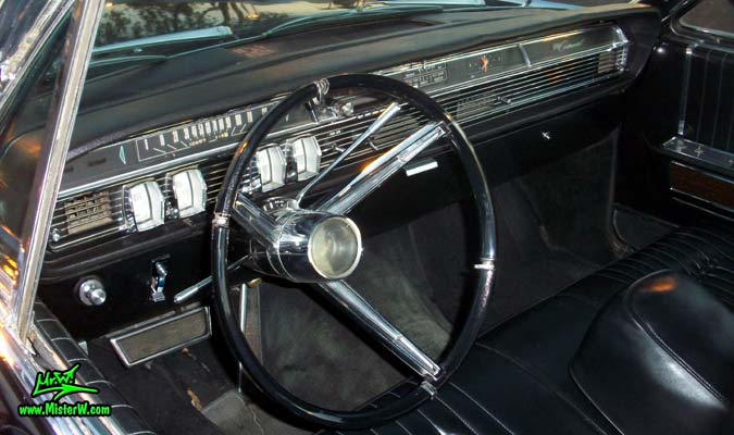 Photo of a black 1964 Lincoln Continental 4 door hardtop sedan at the Scottsdale Pavilions Classic Car Show in Arizona. Dash board & speedometer of a 1964 Lincoln Continental