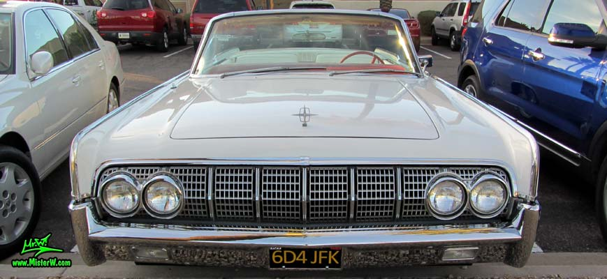 Photo of a white 1964 Lincoln Continental 4 door convertible at the Scottsdale Pavilions Classic Car Show in Arizona. Front view of a 1964 Lincoln Continental convertible