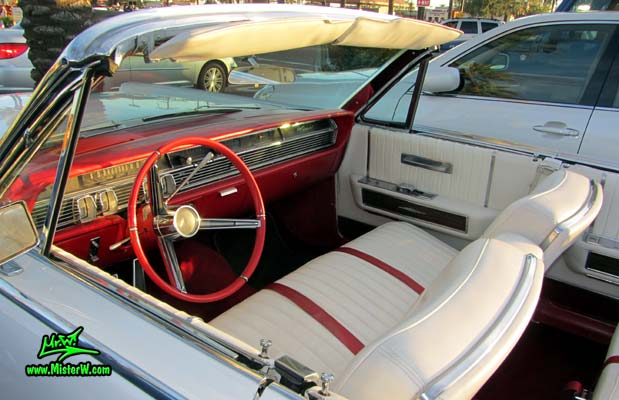 Photo of a white 1964 Lincoln Continental 4 door convertible at the Scottsdale Pavilions Classic Car Show in Arizona. Interior of a 1964 Lincoln Continental convertible
