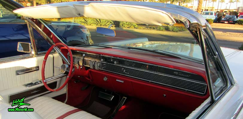 Photo of a white 1964 Lincoln Continental 4 door convertible at the Scottsdale Pavilions Classic Car Show in Arizona. Dashboard & steering column of a 1964 Lincoln Continental convertible