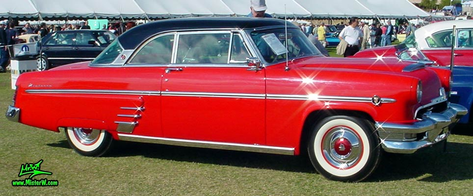 Photo of a red 1954 Mercury Monterey 2 Door Hardtop Coupe at a Classic Car Auction in Scottsdale, Arizona. 1954 Mercury Monterey Coupe Sideview