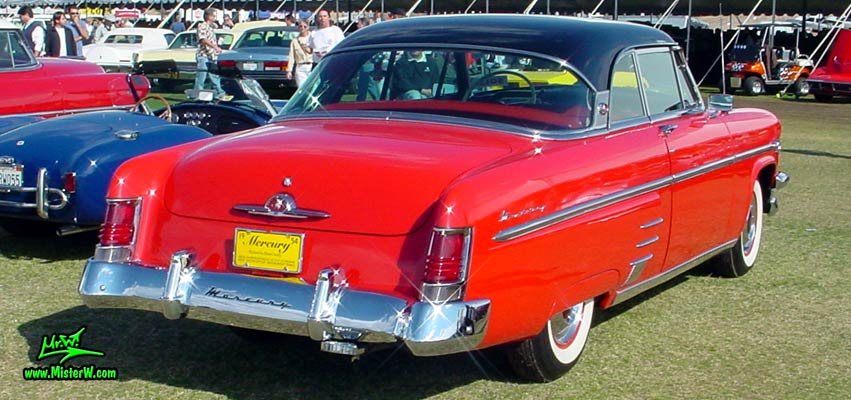Photo of a red 1954 Mercury Monterey 2 Door Hardtop Coupe at a Classic Car Auction in Scottsdale, Arizona. 1954 Mercury Tail Fins