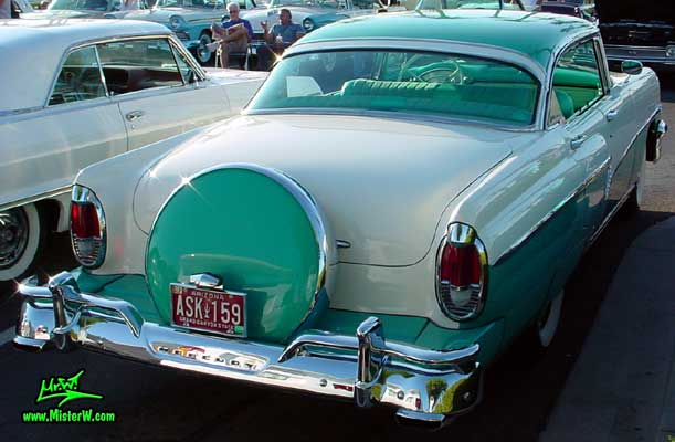 Photo of a white & turkquoise 1956 Mercury Monterey 4 Door Hardtop Sedan at the Scottsdale Pavilions Classic Car Show in Arizona. 1956 Mercury Monterey Sedan Rearview