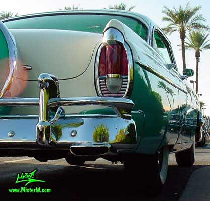 Photo of a white & turkquoise 1956 Mercury Monterey 4 Door Hardtop Sedan at the Scottsdale Pavilions Classic Car Show in Arizona. 1956 Mercury Tail Light